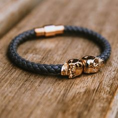 This North Skull bracelet is crafted of premium black nappa leather and is finished with hand carved 18kt gold plated skulls.