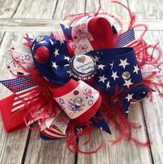 An extravagant patriotic big hair bow for your American Beauty! Thick, red colored ribbons gather with loops of stars and fireworks, featuring hues of red, w. Large Hair Bows, Big Bows, Baby Tutu Dresses, July Baby, Making Hair Bows, Newborn Headbands, Fourth Of July, Blue Feathers, Crafts