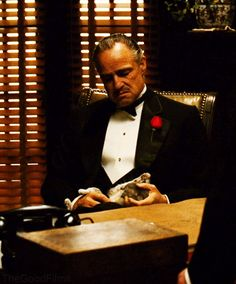 """""""You come to me, and you say """"Don Corleone, give me justice."""" But you don't ask with respect. You don't offer friendship. You don't even think to call me Godfather."""