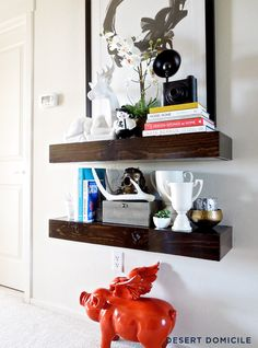 I love the height of these. They look so unique...unlike me...I am a copycat. | DIY Chunky Wooden Floating Shelves