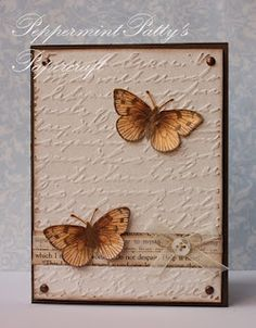 embossed script with butterflies