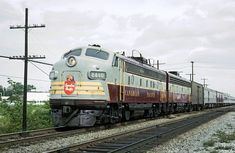 """Canadian Pacific with train the westbound """"Canadian"""" (Montreal, Quebec - Vancouver, British Columbia), stopped at Dorval, Quebec on September Roger Puta photo. Canadian National Railway, Canadian Pacific Railway, Old Train Pictures, Old Gas Stations, Montreal Quebec, Great Western, Upper Peninsula, Train Journey, Picture Logo"""