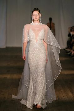 Designers upped the ante at Bridal Fashion Week with high-impact wedding dress cover-ups and accessories. White Bridesmaid Dresses, Top Wedding Dresses, Wedding Dress Trends, Gorgeous Wedding Dress, Beautiful Dresses, Wedding Gowns, Berta Bridal, Bridal Gowns, Bridal Jumpsuit