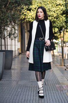 schoolgirl look with pleated tartan skirt