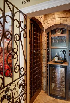 Love a wrought iron door to give definition to the Wine Cellar space. Hughes-Edwards home, Nashville, TN