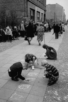 Ralph Crane, East German children playing on the sidewalks of West Berlin while waiting for food and clothing, West Berlin, Germany, July 1953.