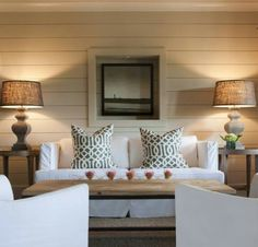 Shiplap walls, window frame as picture's frame, burlap lampshades, and white slip covers. Simple and cute.