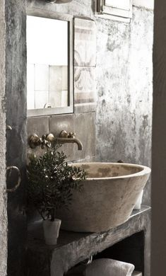 Stone sinks are awesome and make the perfect rustic washroom. See more #interior style ideas on the blog at YasminChopin.com.