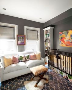 A grey nursery. Love the extra splashes of color to brighten it up. Also love the sofa there for those late nights with a restless baby.
