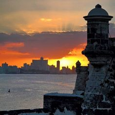 Overlooking Havana's skyline at sunset from the Castillo de Los Tres Reyes del Morro a fortress originally built to protect the port of Havana. Photos by: @dankoday & @yvesy by travelandleisure