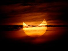 """""""Smiley"""" Eclipse  Photograph by Bullit Marquez, AP  National Geographic"""