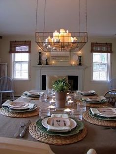Love everything about this room, but my favorite is the place settings and the candle holder/chandelier over the table! Great idea!!!!!!!!!!! Wonderful, affordable lighting!