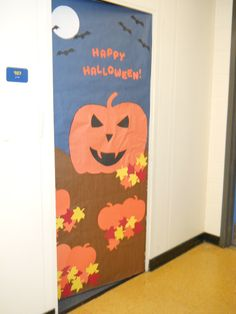 The Great Pumpkin -- made out of large roll paper and construction paper.  This one is door decor, but could also be used for a bulletin board or book display backdrop. Used as part of our Halloween Program.