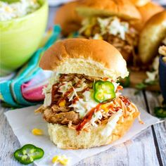 Deliciously smokey southwest inspired pulled chicken sliders topped off with creamy corn & jalapeño slaw, crispy onions and BBQ drizzle. Pulled Chicken, Pulled Pork, Shredded Chicken Sandwiches, Southwest Chicken, Creamy Corn, Chicken Sliders, Crispy Onions, Poultry, Crockpot