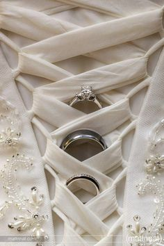 Ok, now this is the first beautiful, sentimental and non-trashy/used ring picture I've seen in a long time - love how it uses the dress too