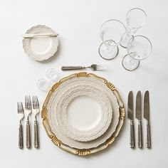 White & gold Florentine Charger + White Lace Dinnerware + Tuscan Flatware in Pewter + Crystal Antique Salt Cellars + Chloe Platinum Rimmed Stemware | Casa de Perrin Design Presentation