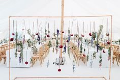 Copper pipe hanging floral installation | Image by Miss Gen Photography