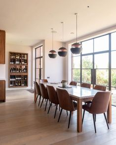 A contemporary walnut veneer kitchen with adjacent dining area and 'liquid metal' bar, in a new purpose-built extension Wine Cabinets, Oak Cabinets, Custom Made Furniture, Furniture Making, Marble Worktops, Liquid Metal, Led Panel Light, Natural Wood Finish, Shaker Kitchen