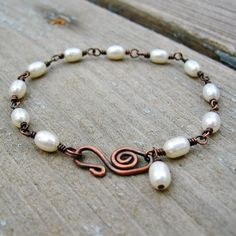 Freshwater Pearls and Antiqued Copper wire wrapped bracelet. $20.00, via Etsy.