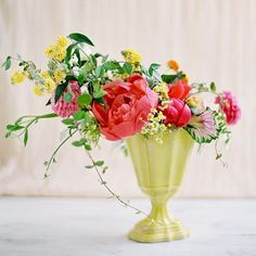 A gorgeous and vibrant floral arrangement. We love the off center styling.