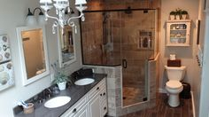 Bathroom remodel includes double vanity and sinks and tile corner shower