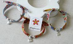 Pulseras con cinta de algodón Liberty London Pulseras con cintas de algodón de gran calidad estampadas marca Liberty London, con cuentas plateadas y cierre corredizo valido para distintos tipos de muñeca.  http://www.pihippie.com/p/blog-page_25.html