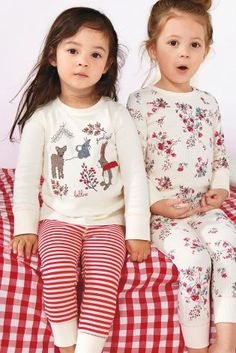 Two Pack Character Appliqué Snuggle Fit Pyjamas (12mths-8yrs) from Next. A Cute Gift For Little Ones This Christmas.
