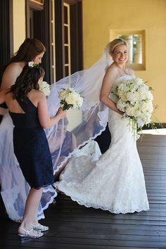 Bridesmaids in black, knee-length @m_lhuillier dresses | Brides.com