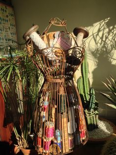 Beautiful wire mannequin display filled with Charming Vintageness.