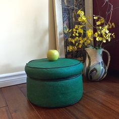 Ah, put your feet up on this wonderful round mid century green faux leather ottoman. This vintage footrest is crafted out of green textured vinyl with black flecks and highlighted with a decorative black piping. The perfect addition to your retro decor!  This vintage foot stool in in fabulous vintage condition, with no rips or holes, there are some scuff marks on the base of the ottoman which are consistent with use and an item of this age. This is a solid piece and has a good weight to it…