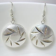 Textured hollow cut out surgical steel earrings by AndesBeads