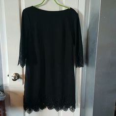 Black shift dress with lace on sleeve and hem Gently used, very flattering shift dress ECI Dresses Midi