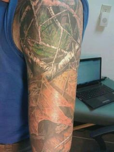 Car tattoos on pinterest hunting tattoos browning and for Camo sleeve tattoo