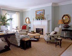 Green-blue living room + sisal rug + batik sofa: Farrow & Ball's 'Teresa's Green' In this Wellington, Florida living room, walls are painted Farrow & Ball's Teresa's Green. Interior design by Bill Brockschmidt and Courtney Coleman. House Beautiful.