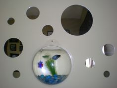 We love this mod wall decor idea! WallPops peel and stick mirror decals with a wall mounted fish tank!