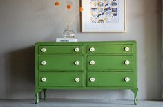 this sideboard has had new life breathed into it with green and white colors!