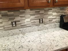 Superieur Gray Subway Mosaic Wall Tiles On Spring Valley Quartz Countertops.