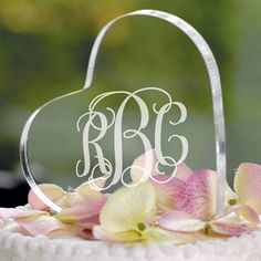 Simple and sweet, this personalized acrylic heart cake topper fits in with both modern and traditional wedding decorations to create an everlasting wedding keepsake. This cake topper can be ordered at http://myweddingreceptionideas.com/personalized_acrylic_heart_cake_topper.asp