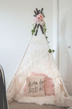 This is a lovely girl nursery decor. Like the flowers on top of the teepee! Such a cool kid's room decor ideas, especially for a little girl bedroom. Toddler and children's will love playing under this cute teepee. Add cushions and plush inside to make it more comfortable. If you like this kids room decorating idea, follow us and visit mysleepymonkey.com #shabbychicbedroomsdecoratingideas