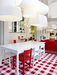 I don't love particularly red in a house but this is interesting, fresh and energizing! :D I love the lamps as well...maybe they are too many but well assorted with all the rest. :)
