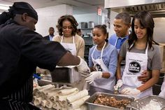 President Barack Obama checks in on First Lady Michelle Obama and daughters Sasha and Malia as they prepare burritos while volunteering at the DC Central Kitchen in Washington, D., on Martin Luther King Day, January Malia Obama, Barack Obama Family, First Black President, Mr President, Obama Photos, Presidente Obama, Malia And Sasha, Barrack Obama, Michelle And Barack Obama