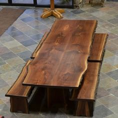 Dining table and benches made from natural edge walnut