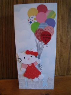 "Splitcoast Stampers - Hello Kitty punch art uses the following punches - 2 3/8"" Extra Large Scalloped Circle (jumper), Word Window (neckline), 5-petal flower (ears), 2 x 1 3/8"" extra large oval (head), 1/2"" circle (hands), Itty Bitty Shapes circle (center of hair bow), Punch Bunch balloon"
