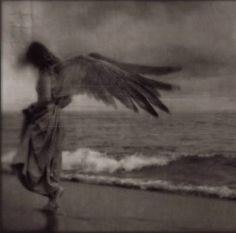 angel on the beach by Kamil Vojnar