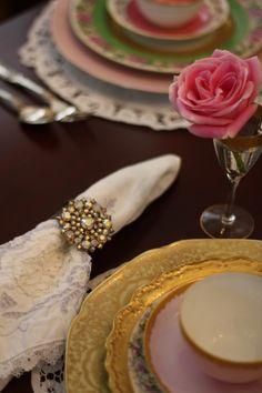 DIY napkin holder...take a broach/pin & glue to basic napkin ring...