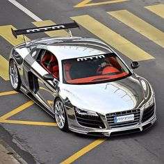 Chrome Audi R8. Homage to the Auto Union silver arrows of 1930s Grand Prix legend. Their polished aluminum skin showcased their light weight and boasted the first mid-engined racing car design.