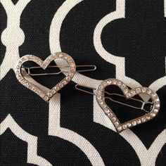 Heart hair pins Discounted Bundles ▪️Please use the offer feature  ▪️Ships within 24 hours ✈️ ▪️No tradesNo Paypal ▪️ Love the item but not the price?  Make an offer!  ▪️Questions?  Don't be shy!  Feel free to ask  ▪️Condition - NWOT ▪️Size - One Size ▪️Material - Mixed ▪️Description - Rhinestone heart hairpins with snap closure. Accessories Hair Accessories