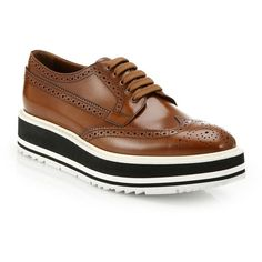Prada Platform Leather Wingtip Brogues ($950) ❤ liked on Polyvore featuring shoes, oxfords, apparel & accessories, tobacco, lace up flats, platform oxford shoes, wingtip oxford shoes, wingtip shoes and platform shoes