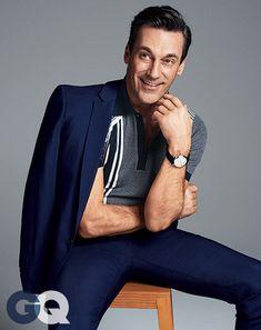 Jon Hamm. Polo shirt by Prada. Suit by Prada. Watch by Longines.