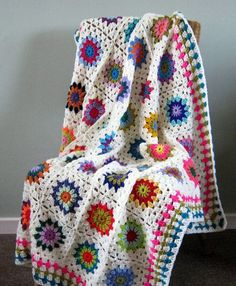 Check out this item in my Etsy shop https://www.etsy.com/uk/listing/212991471/flower-power-crochet-blanket-sunburst